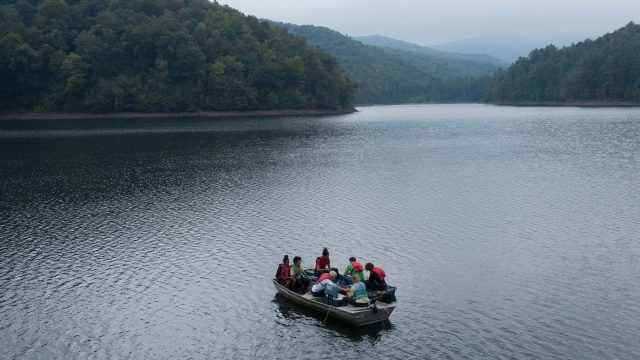 Students on boats over Switzer Lake