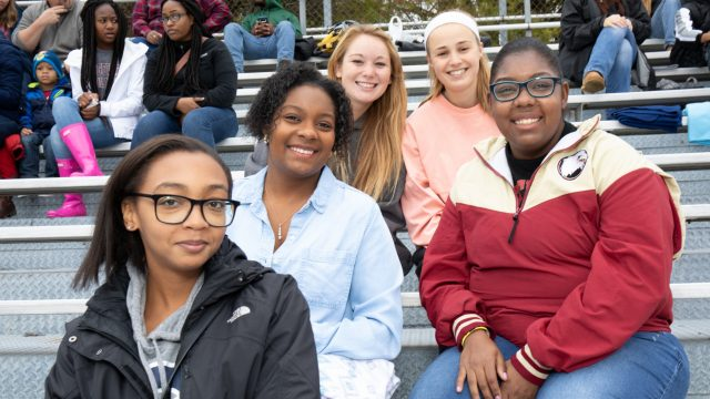 Five female students at a sporting event