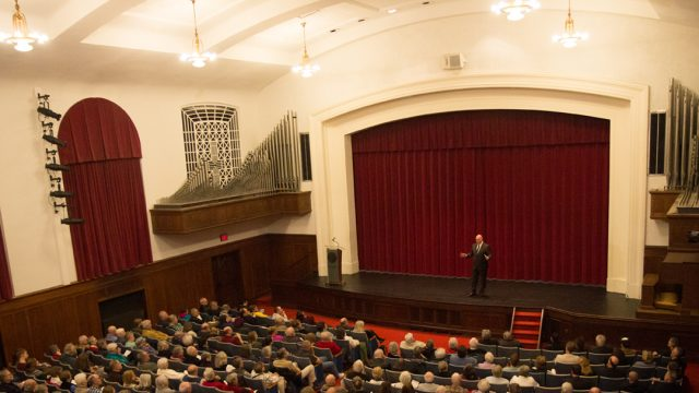 A speaker talks to a group in Cole Hall's auditorium