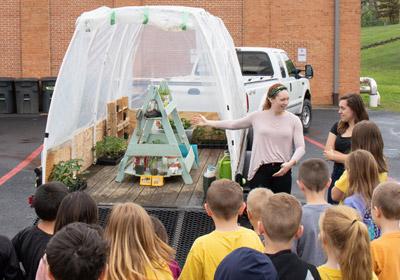Lauren Buckhout giving a lesson to children at the greenhouse  Lauren Buckhout giving a lesson to children at the greenhouse