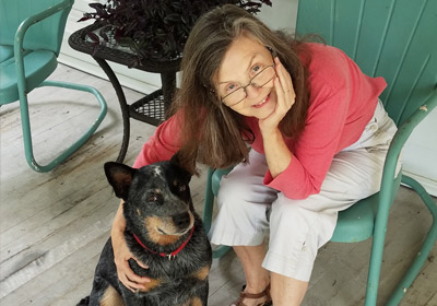 Photo of Sheila Turnage with her dog|Photo of Sheila Turnage with her dog