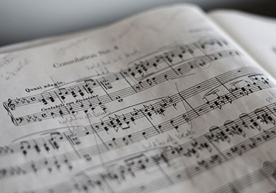 Photo of a piece of sheet music|Photo of the Jazz Ensemble|Photo of a piece of sheet music