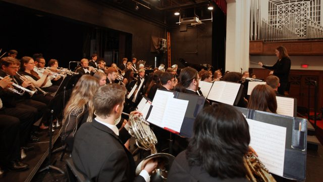 photo of symphonic band rehearsal conducted by Dr. Carrillo